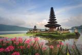 Pura Ulun Danu temple with pink flowers, Bali, Indonesia
