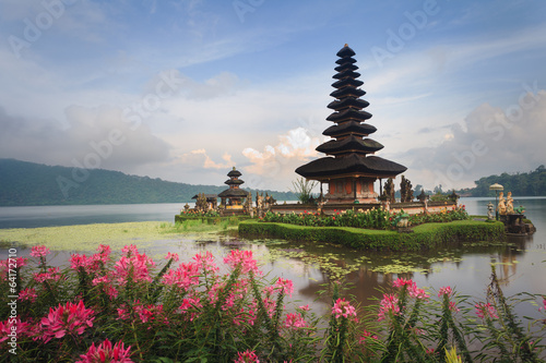 Foto op Canvas Indonesië Pura Ulun Danu temple with pink flowers, Bali, Indonesia