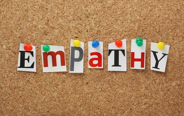The word Empathy on a cork notice board