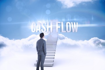 Cash flow against shut door at top of stairs in the sky