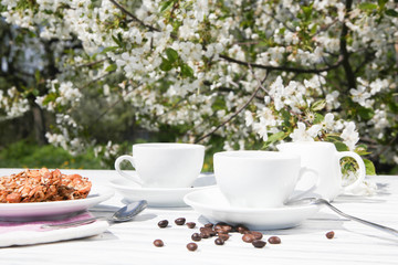 Still life of a cup of coffee on a blossoming background
