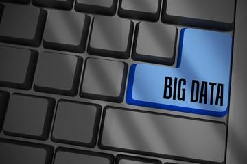 Big data on black keyboard with blue key