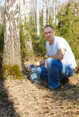 man collects birch sap