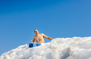 naked man on top of the ice mountain against