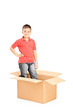 Little boy standing in a carton box