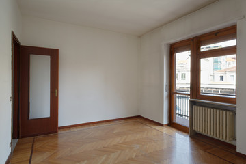 Empty room in normal apartment with wooden floor