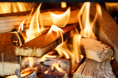 Leinwandbild Motiv firewood burning in fireplace