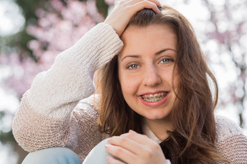 Happy girl wearing braces spring portrait