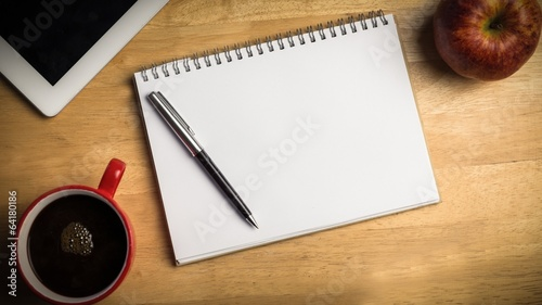 Overhead of notepad and pen