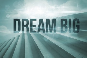 Dream big against steps against blue sky