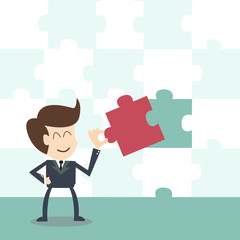 businessman completing the final puzzle piece