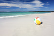 Colourful beach ball on the seashore by the ocean