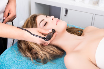 Woman doing cosmetic procedures