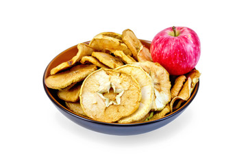 Apple fresh red and slices of dried in bowl
