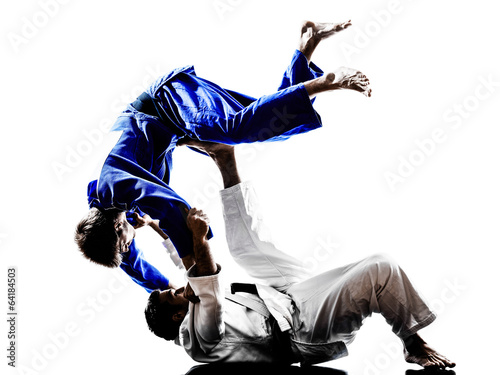 judokas fighters fighting men silhouettes - 64184503