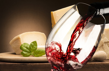 Still life with  cheese and red wine on the wooden table