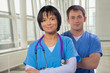 smiling medical team man and woman with crossed arms  looking at