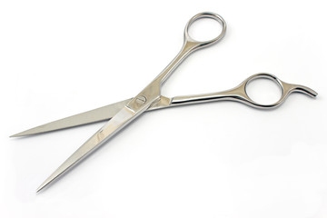 Professional haircutting scissors isolated on white.