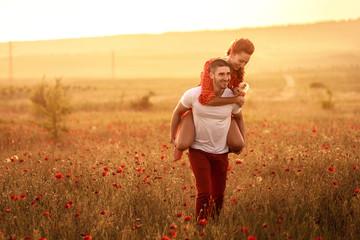Couple in the poppy field