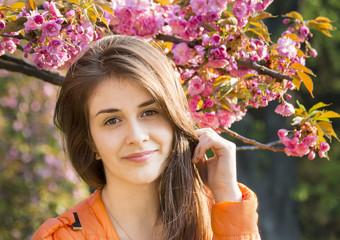 happy girl in the flowers of sakura
