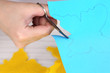 Women hand cutting colorful paper with scissors