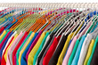 Colored shirts on hangers steel closeup.