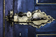 ancient gold door lock on blue door