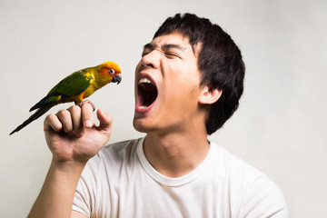 Asian men with parrot - Sun Conure