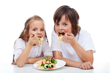 Kids eating a pasta dish