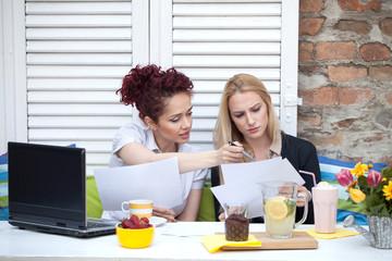Two business women on a coffee break