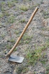 A hoe, garden tool