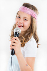 Pretty little girl singing in microphone