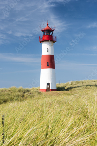 Lightouse on dune. - 64198386