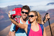 Couple Taking a Photo of Themselves with Phone