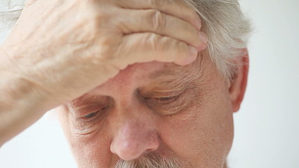 mature man with headache