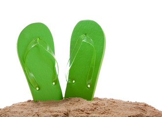 Flipflops in sand on white with copy space
