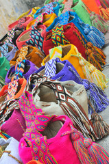 Multi-colored colombian bags on a market stall in Cartagena