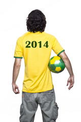 Young man of backs with ball and green and yellow jersey