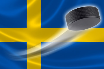 Hockey Puck Streaks Across Sweden's Flag