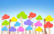 Hands Holding Colorful Cloud Shaped Speech Bubbles