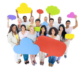 Group of People Holding Cloud Shaped Speech Bubbles