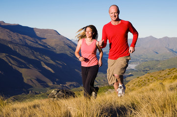 Couple Jogging Together in Mountain Scenic