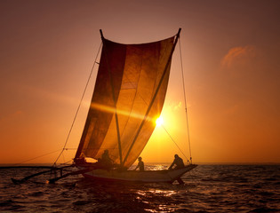 Fishermen on a Catamaran at Sunset