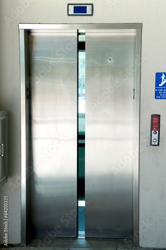 stainless steel elevator doors closing - 64203335
