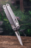 multitool, multi purpose tool with knife stuck on wood poster