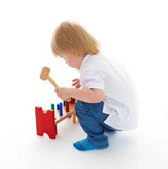 little boy in the classroom at Montessori environment.