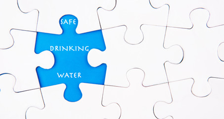 Missing  puzzle revealing the SAFE DRINKING WATER words