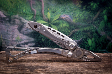 multitool, multi purpose tool woods background