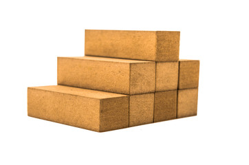 jenga blocks forming a piramid on a white background