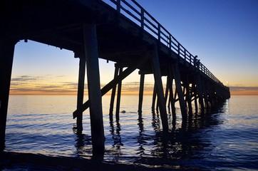 Jetty silhouette at sunset on Grange Beach, South Australia